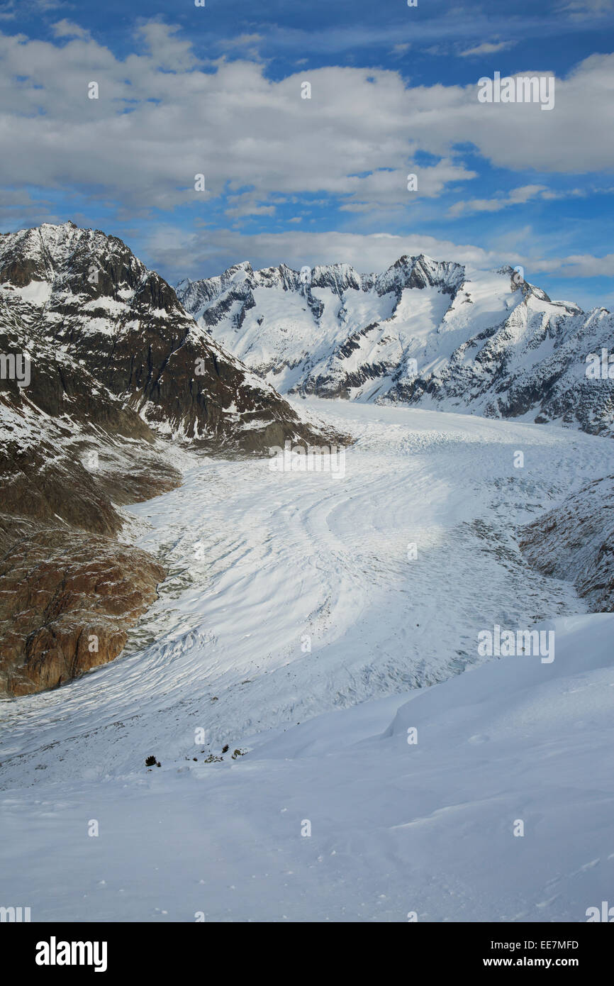 View over snow covered mountains in winter surrounding the Swiss Aletsch Glacier, largest glacier in the Alps, Switzerland - Stock Image