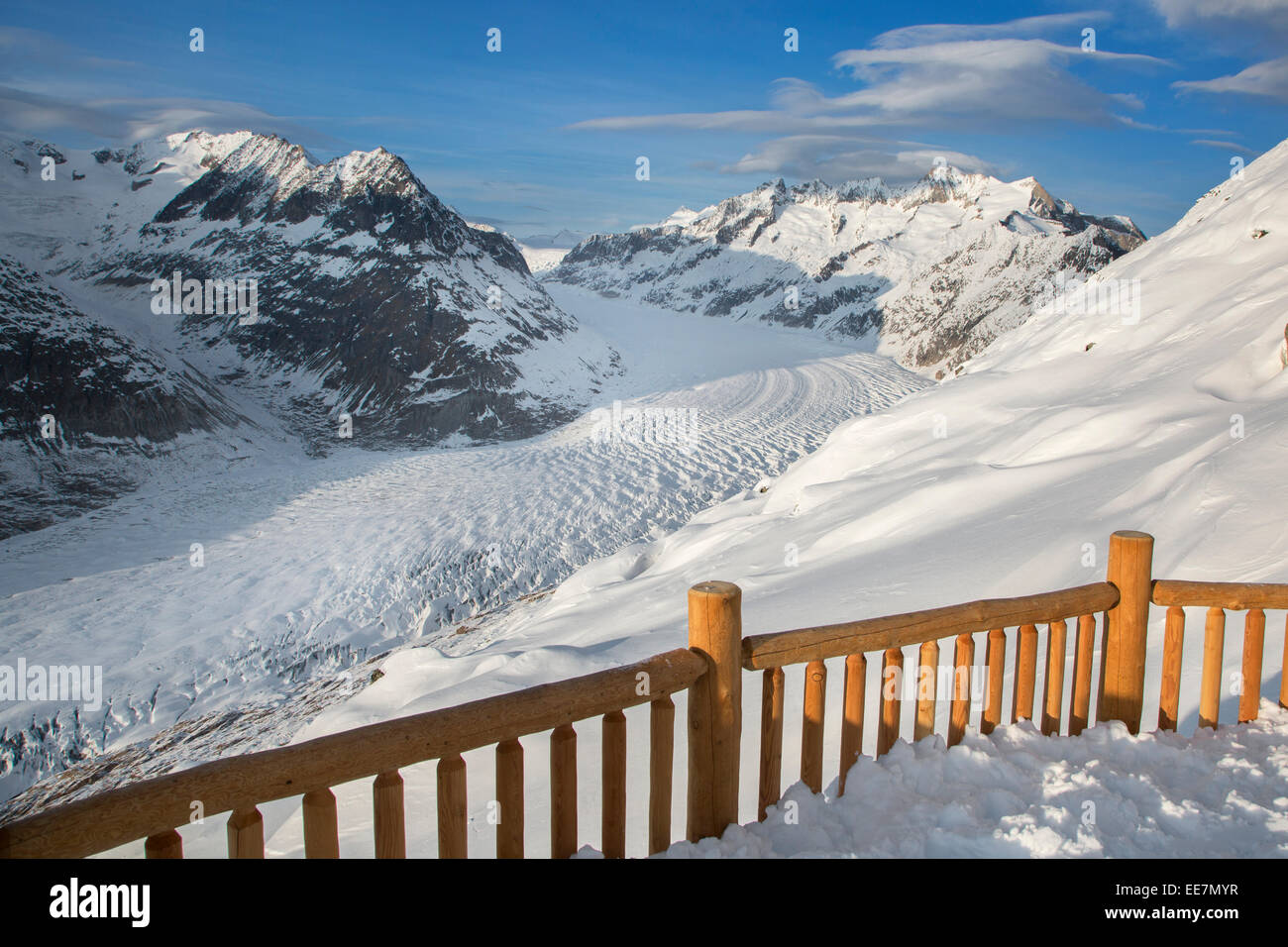 View over the mountains in winter surrounding the Swiss Aletsch Glacier, largest glacier in the Alps, Switzerland - Stock Image