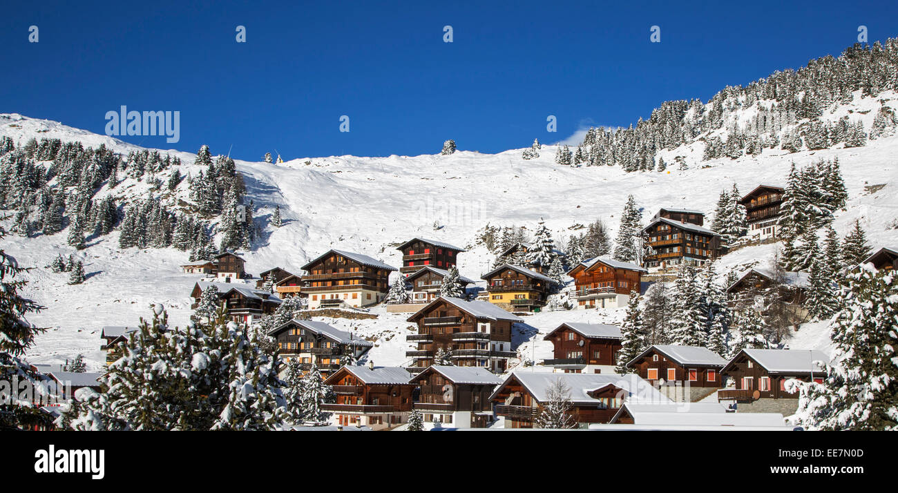 Swiss wooden chalets in the snow in winter in the Alps at the mountain village Riederalp, Wallis / Valais, Switzerland - Stock Image
