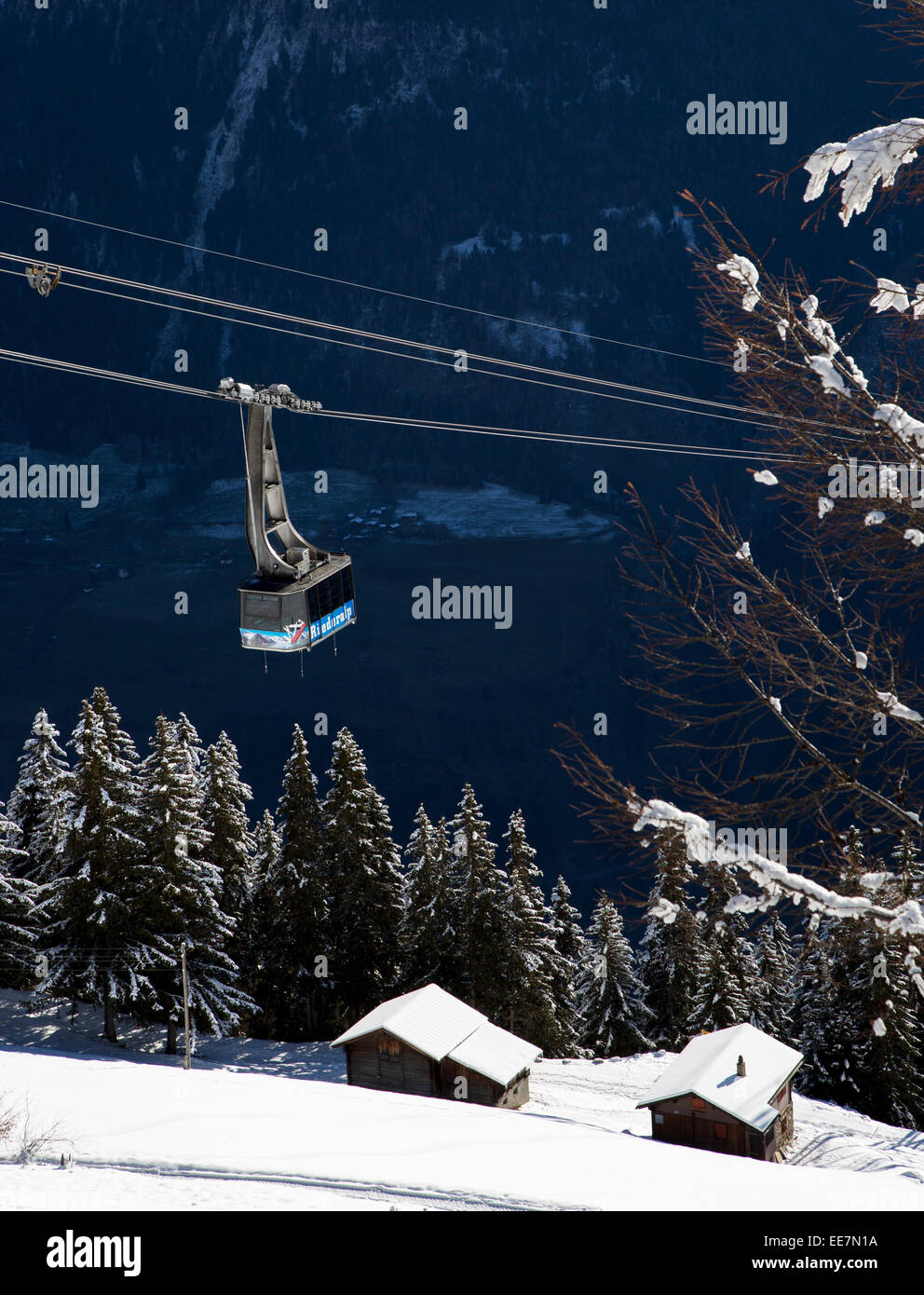 Gondola lift and view over the mountains in the snow in winter in the Swiss Alps at Riederalp, Wallis / Valais, - Stock Image