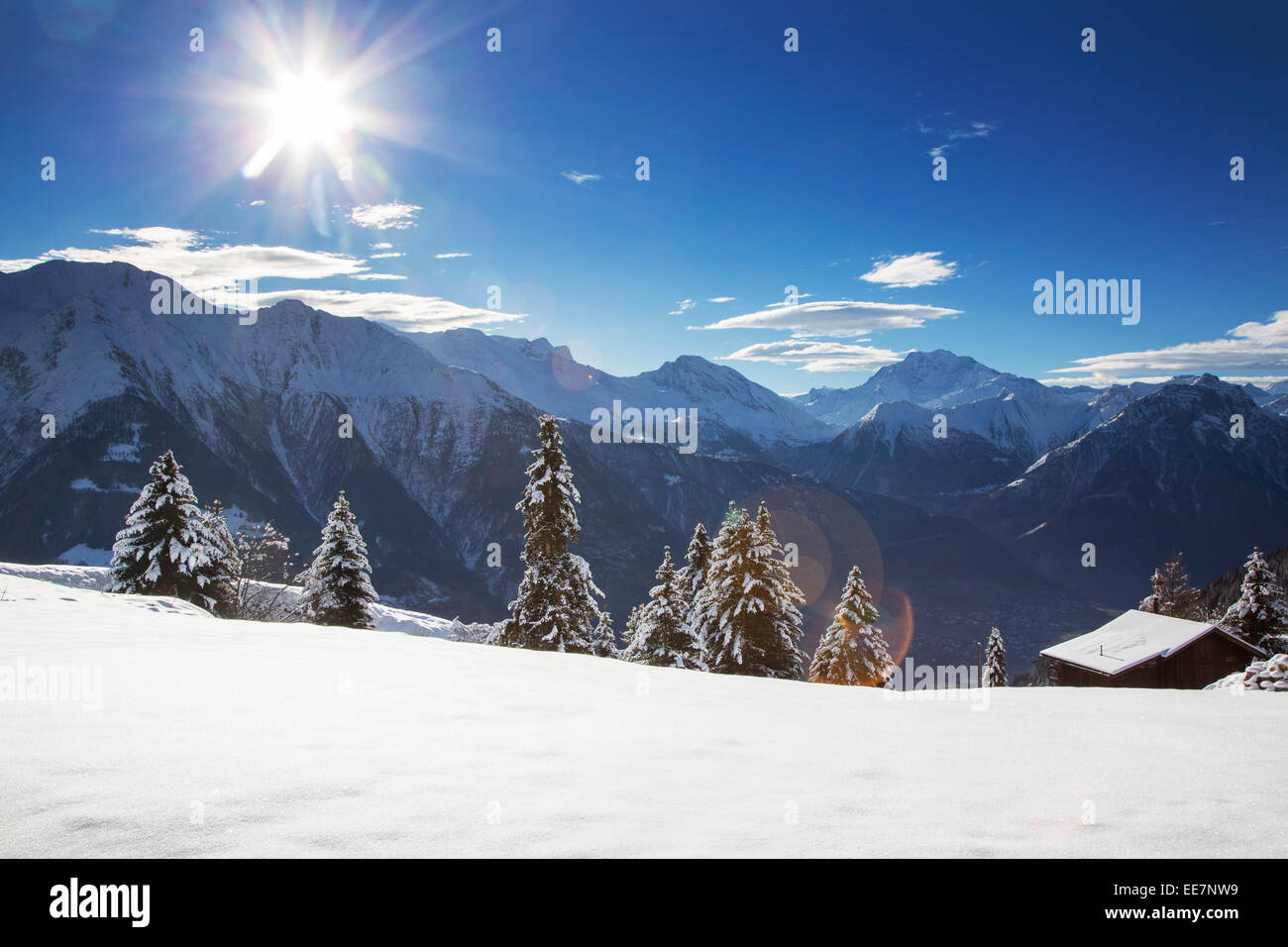 Swiss wooden chalet in the snow in winter in the Alps, Wallis / Valais, Switzerland - Stock Image