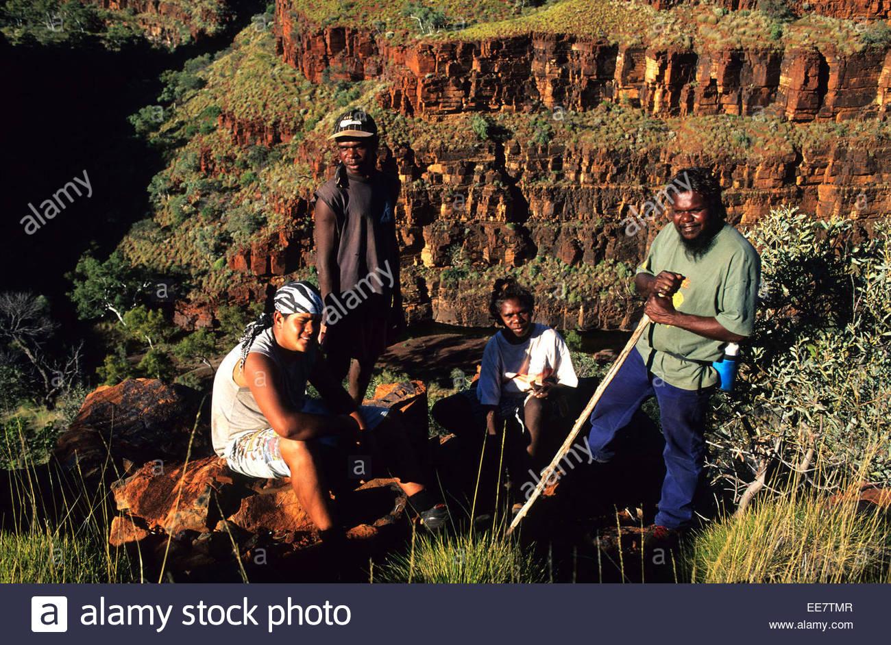 Aboriginals hikers and guides having a rest, Karijini National Park, Australia. - Stock Image