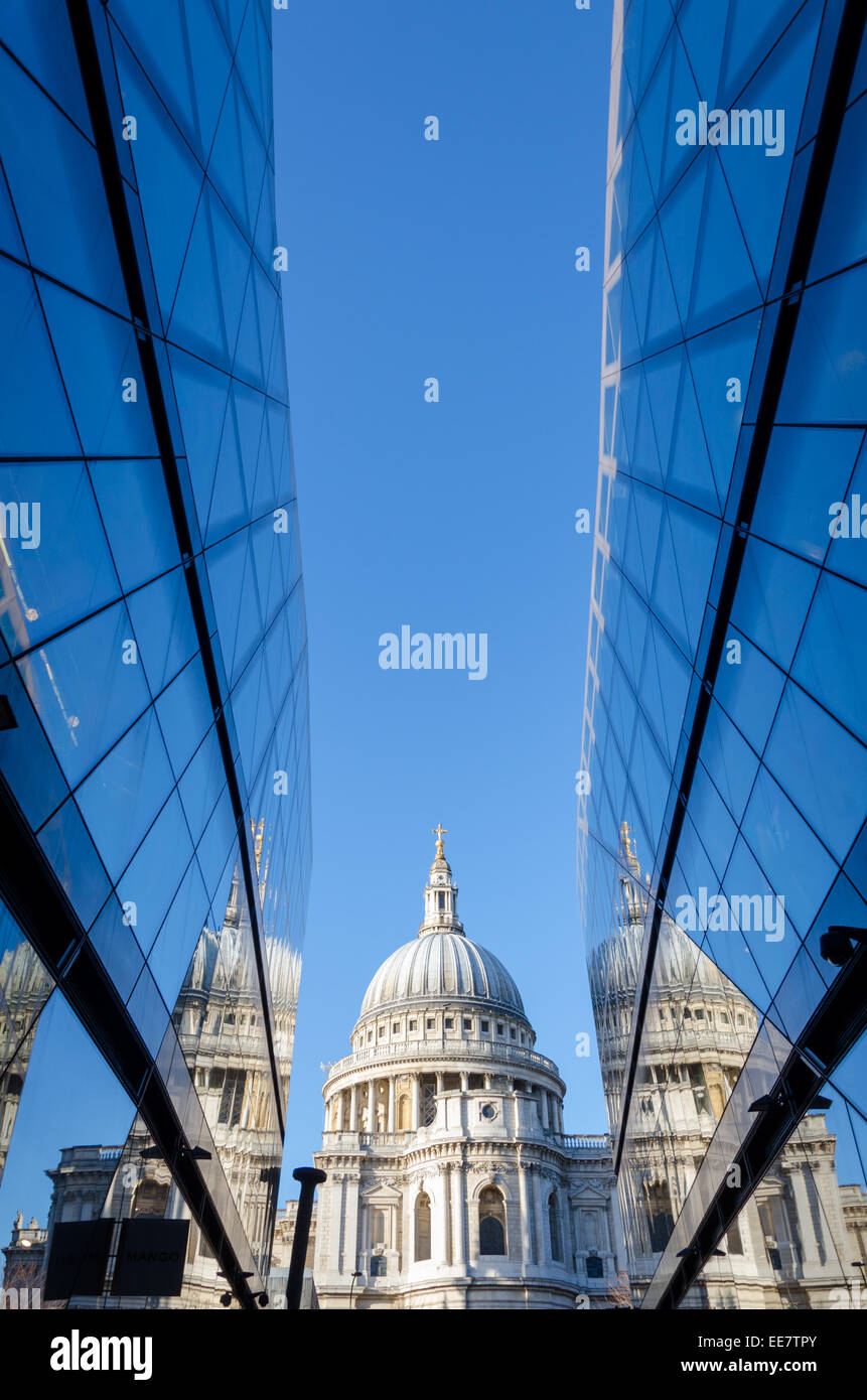 St Paul's Cathedral reflected in the glass of One New Change shopping centre. City of London, UK - Stock Image