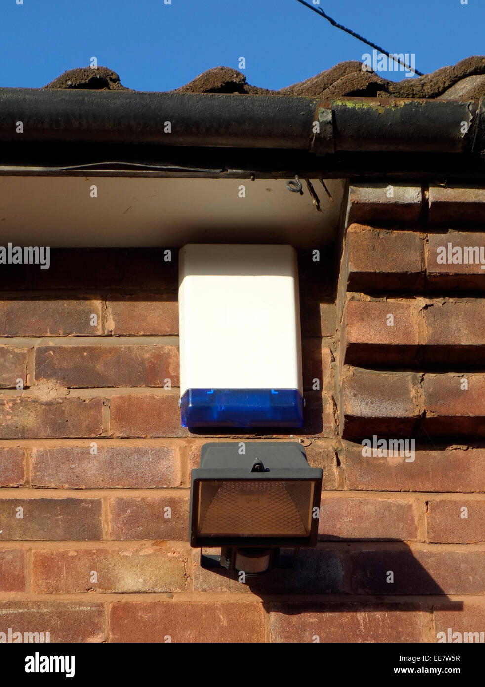 House Alarm Box and Halogen Security Lighting on an Exterior House Wall, UK PROPERTY RELEASED Stock Photo