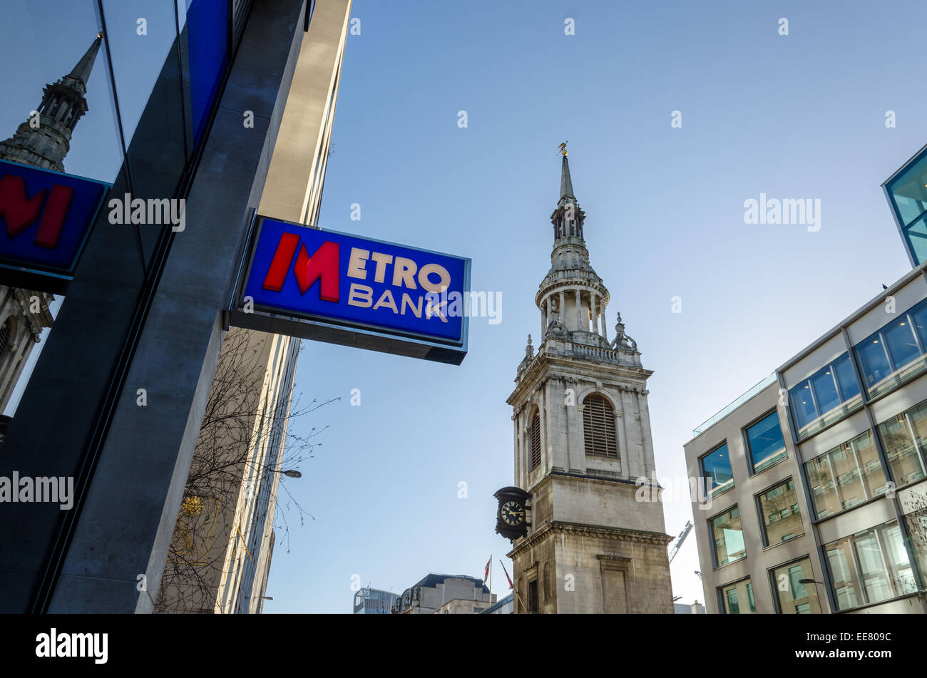 Metro Bank sign and St Mary-le-Bow Church. Cheapside, London. - Stock Image