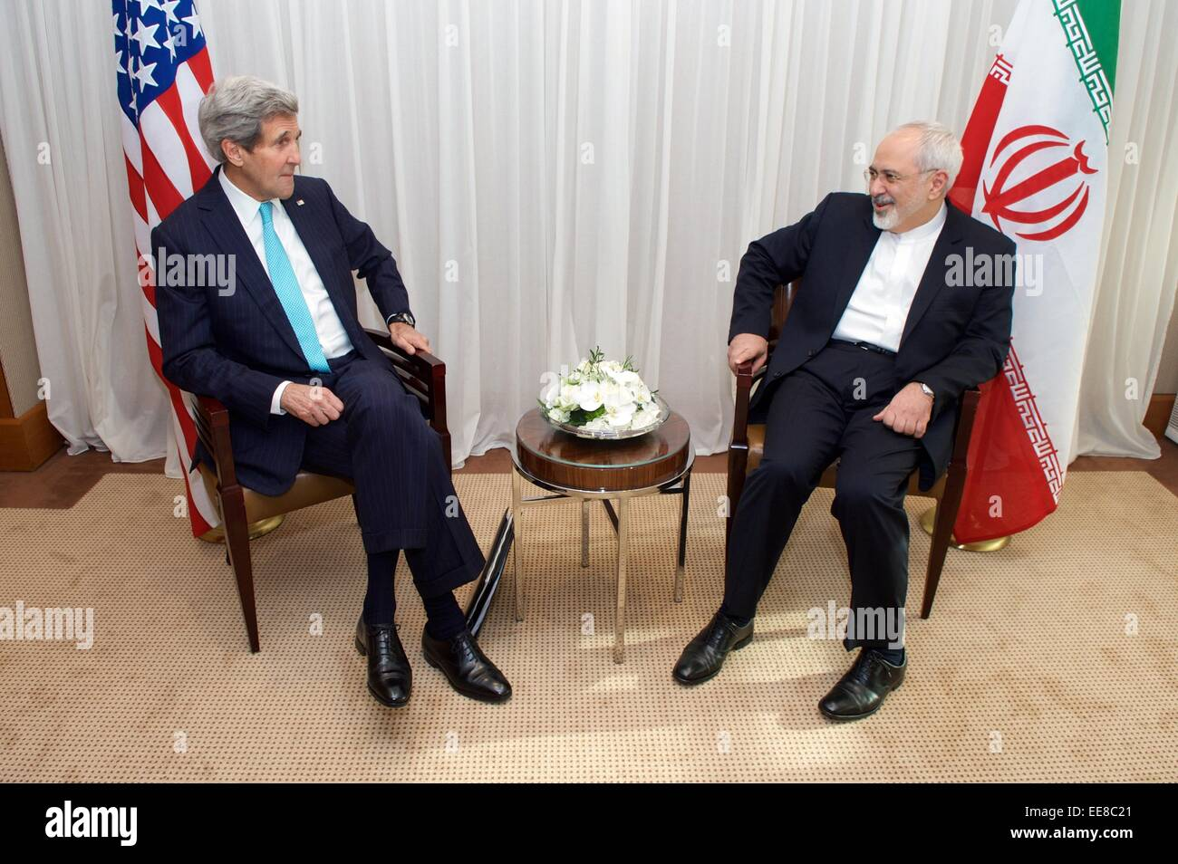 US Secretary of State John Kerry sits with Iranian Foreign Minister Zarif during a bilateral meeting before negotiations Stock Photo