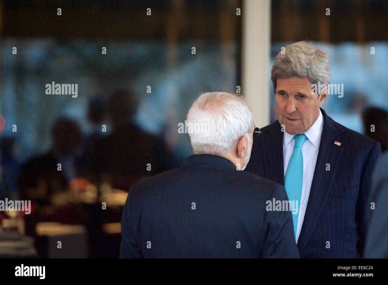 US Secretary of State John Kerry chats with Iranian Foreign Minister Zarif during a break in negotiations about Stock Photo