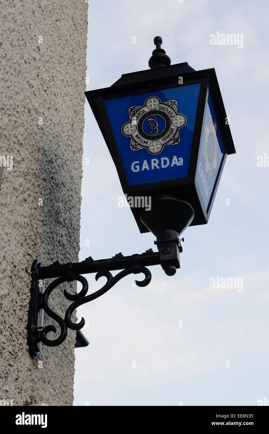 Lamp outside a Garda office. - Stock Image