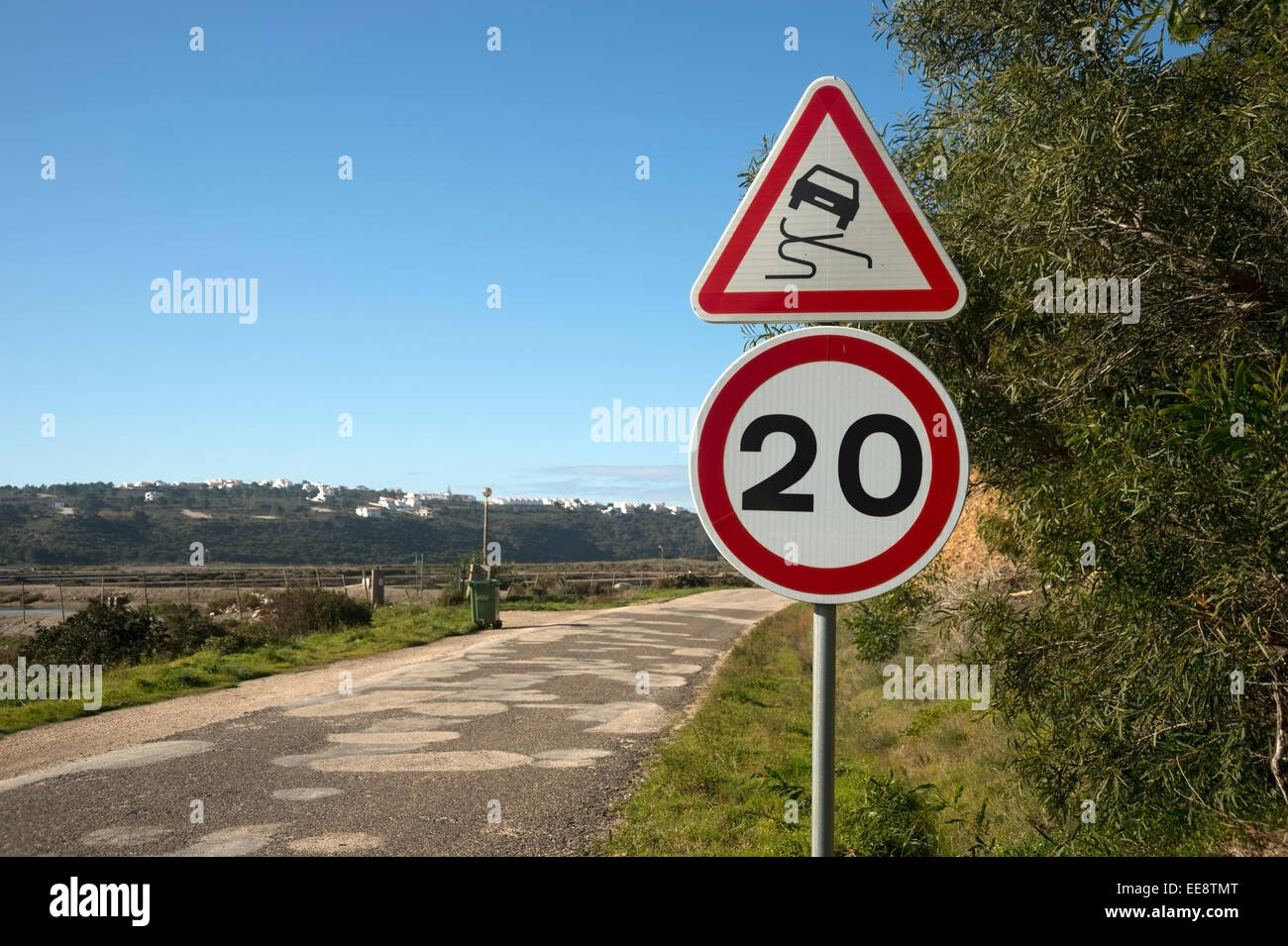 20 kph mph and slippery road surface road signs - Stock Image