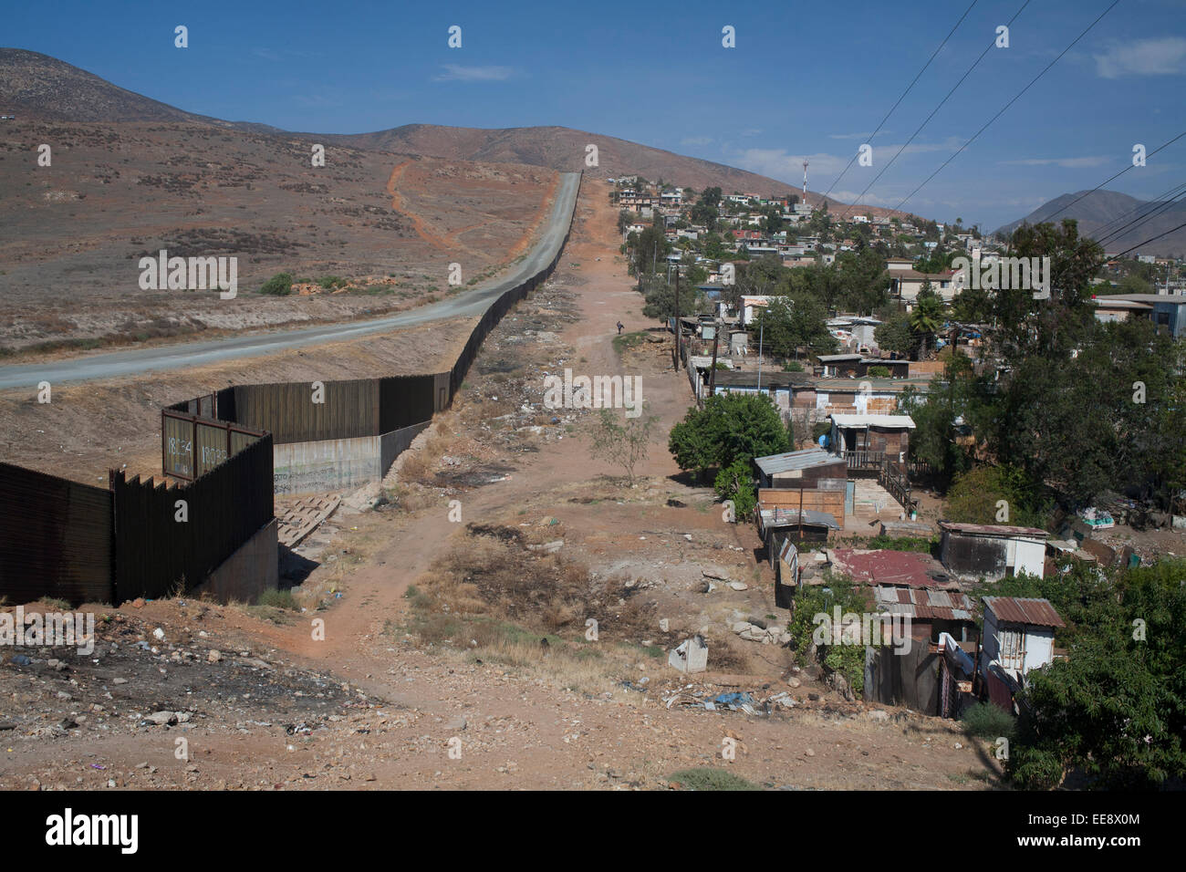 The US-Mexican border line from Tijuana in Mexico. Stock Photo