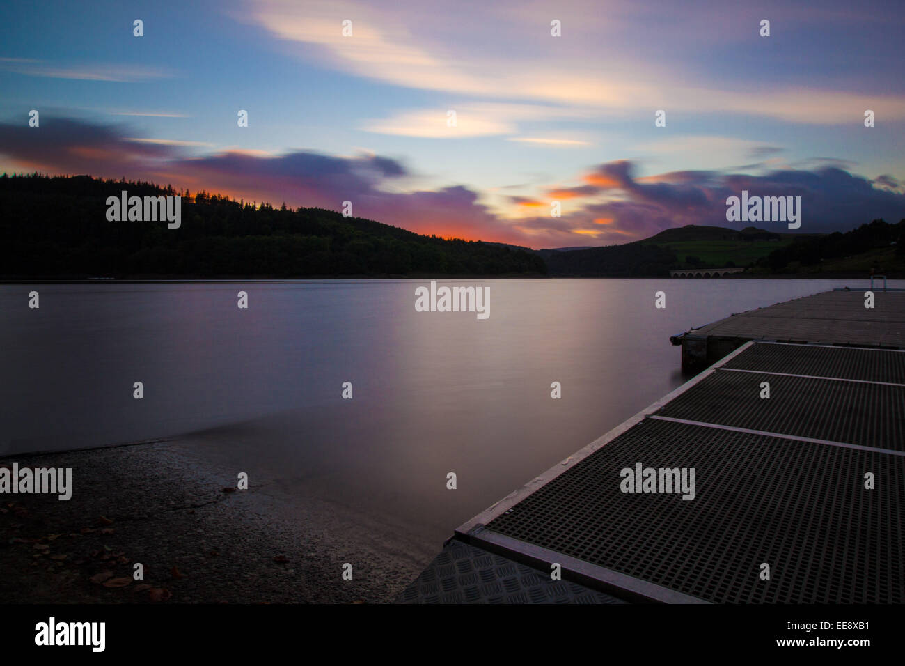 Ladybower Reservoir, Sunset with smooth water - Stock Image