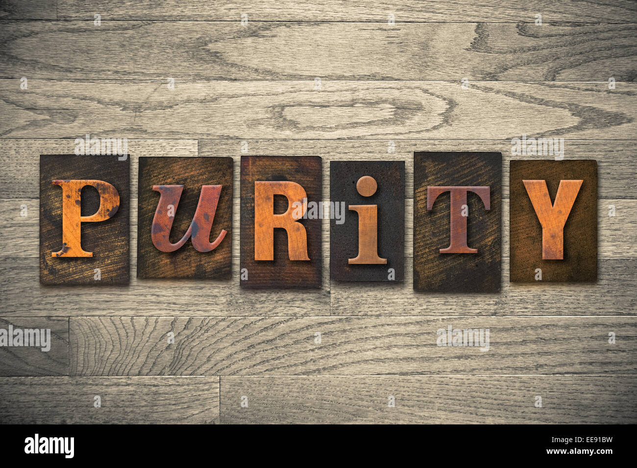 The word 'PURITY' written in wooden letterpress type. - Stock Image