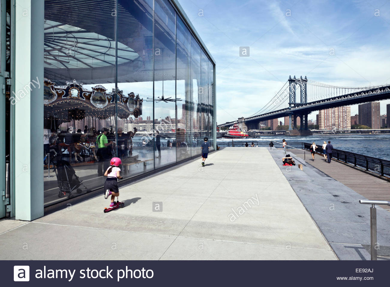Empire Fulton Ferry park in Brooklyn DUMBO with Jane's carousel and the Manhattan Bridge - Stock Image