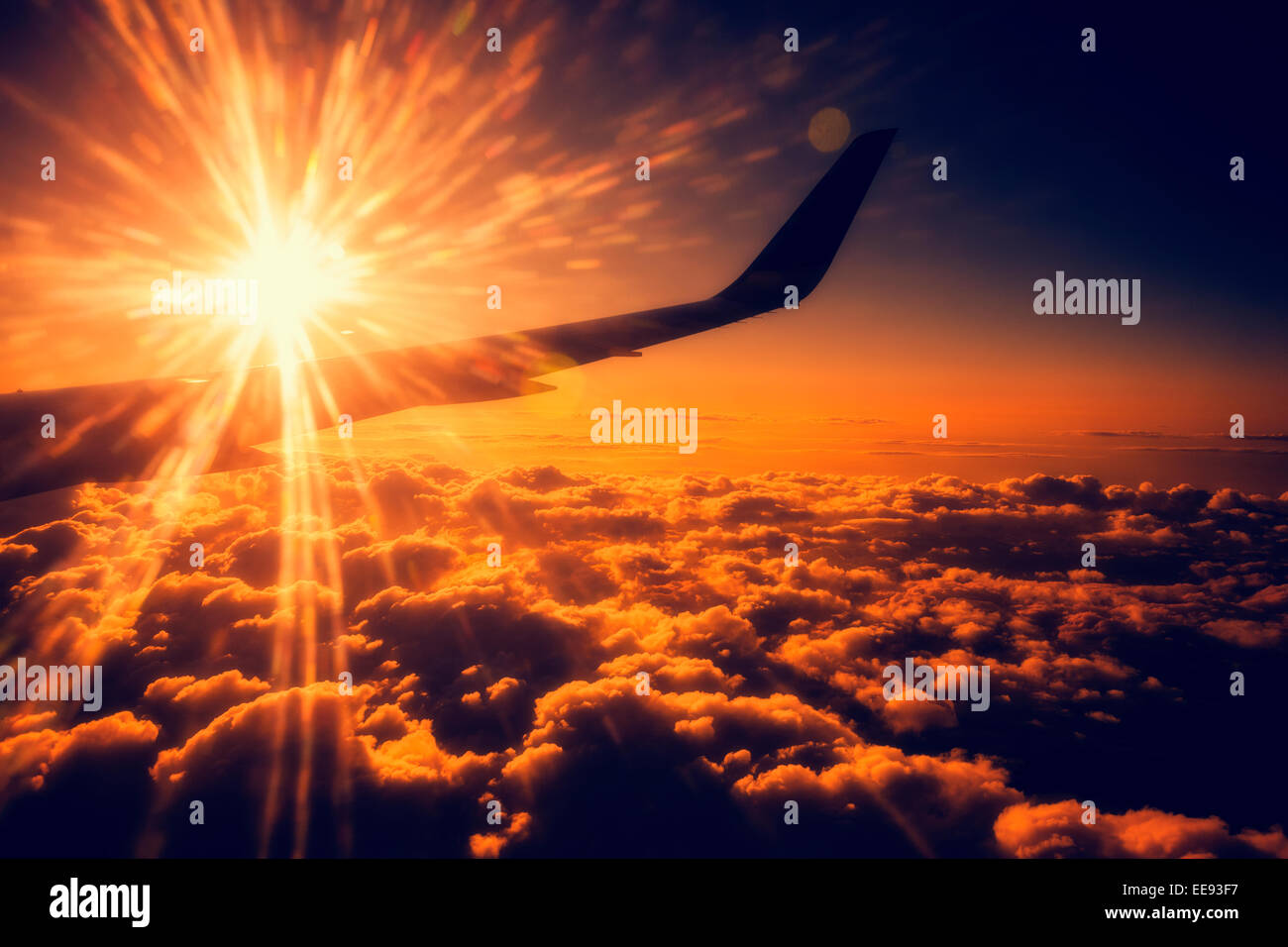 view of airplane wing in the air from inside cabin - Stock Image
