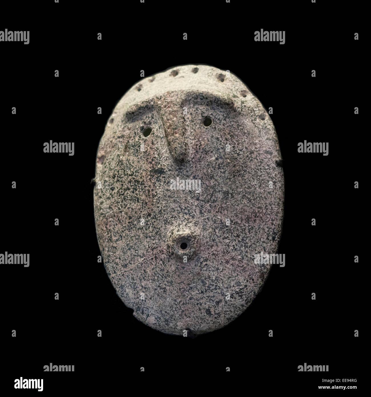 Primitive stone mask Chilean Museum for Pre-Columbian Art, Museo Chileno de Arte Precolombino in Santiago Chile - Stock Image