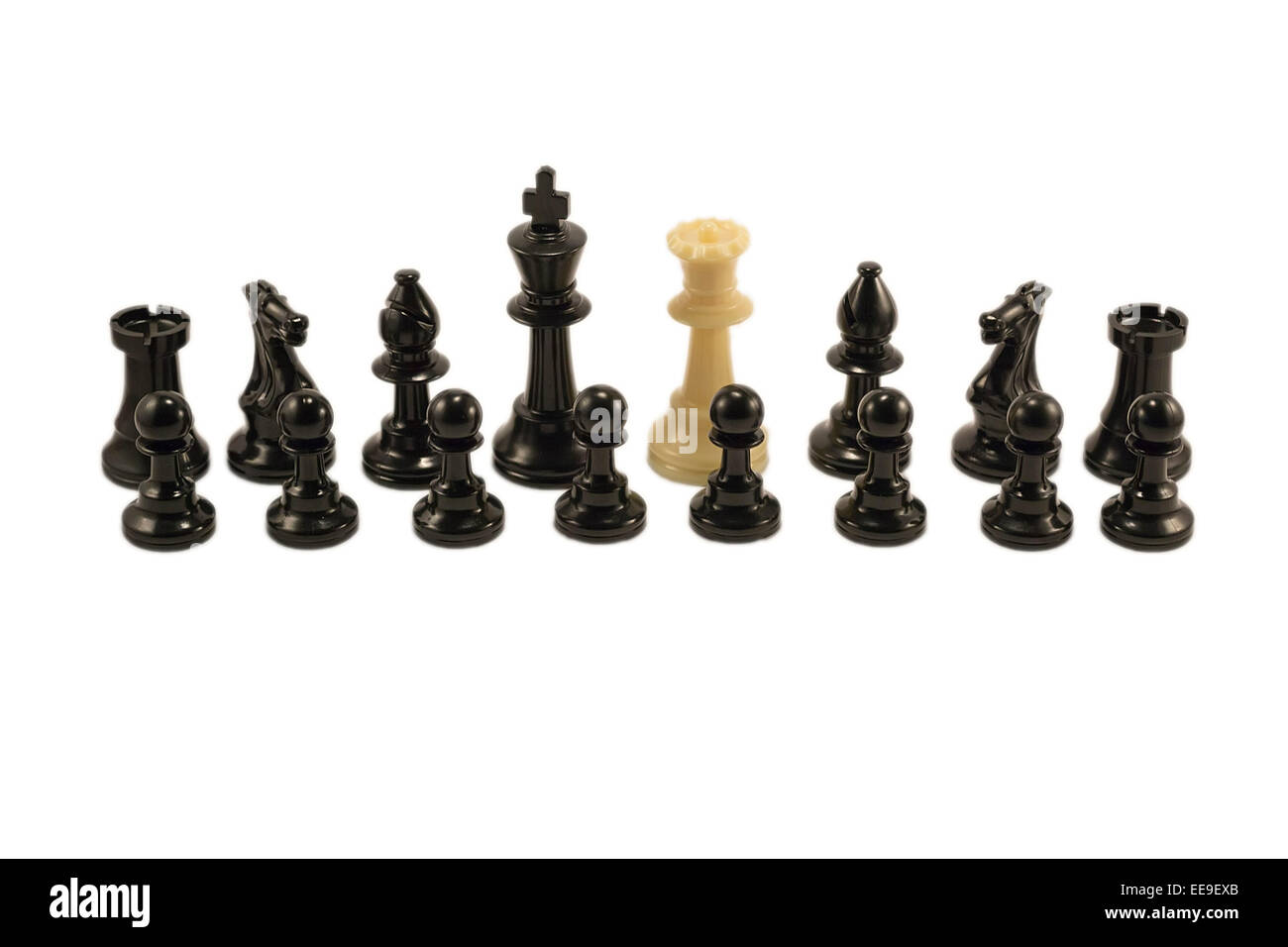 White queen standing alongside with the black chess pieces Stock Photo