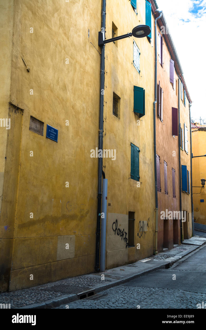 Narrow lane with medieval houses, Perpignan, Pyrenees-Orientales, France - Stock Image