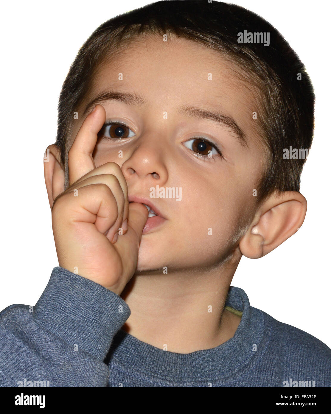 Little boy sucking his finger - Stock Image