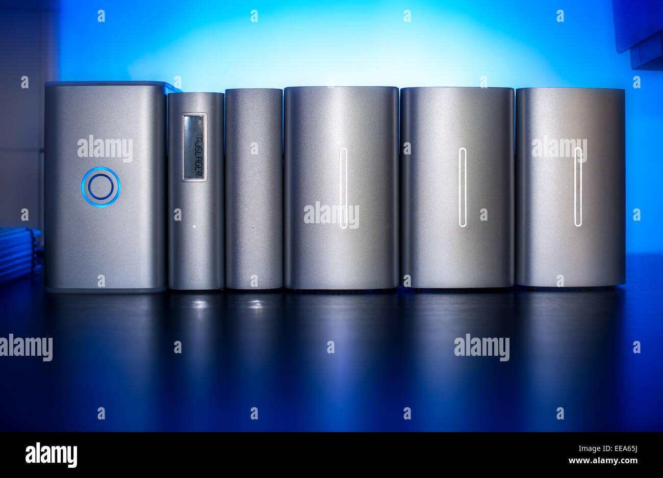 Memory, external drives many blue desk storage data traffic congestion on digital safe safety silver metal high - Stock Image