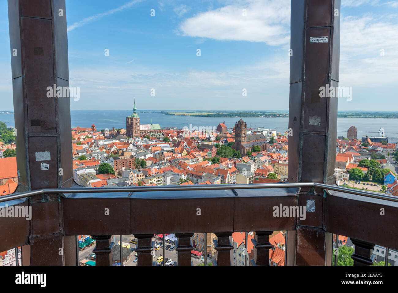 Rostock Hanseatic town, tourism, houses, sea, coast, blue sky, over the rooftops, as seen from the bell tower, look - Stock Image