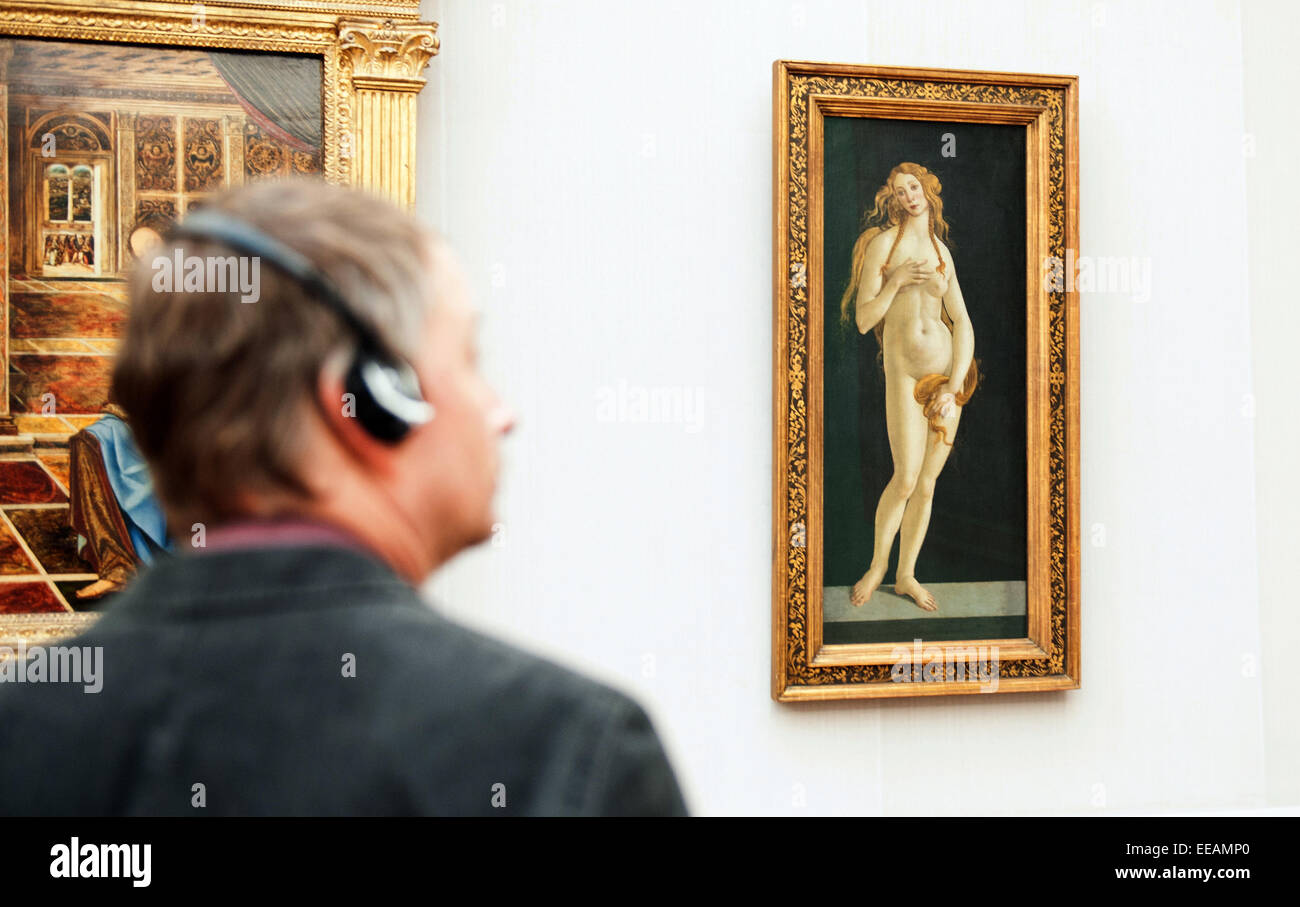 Berlin, Germany. 15th Jan, 2015. A visitor looks at the painting 'Venus' from Sandro Botticelli from 1490 during Stock Photo
