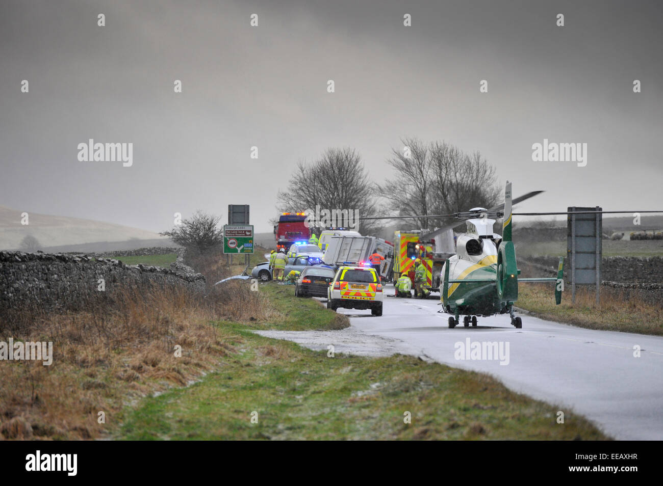 Air Ambulance attending a road traffic accidentin icy weather, Kirkby Stephen, Cumbria, UK - Stock Image