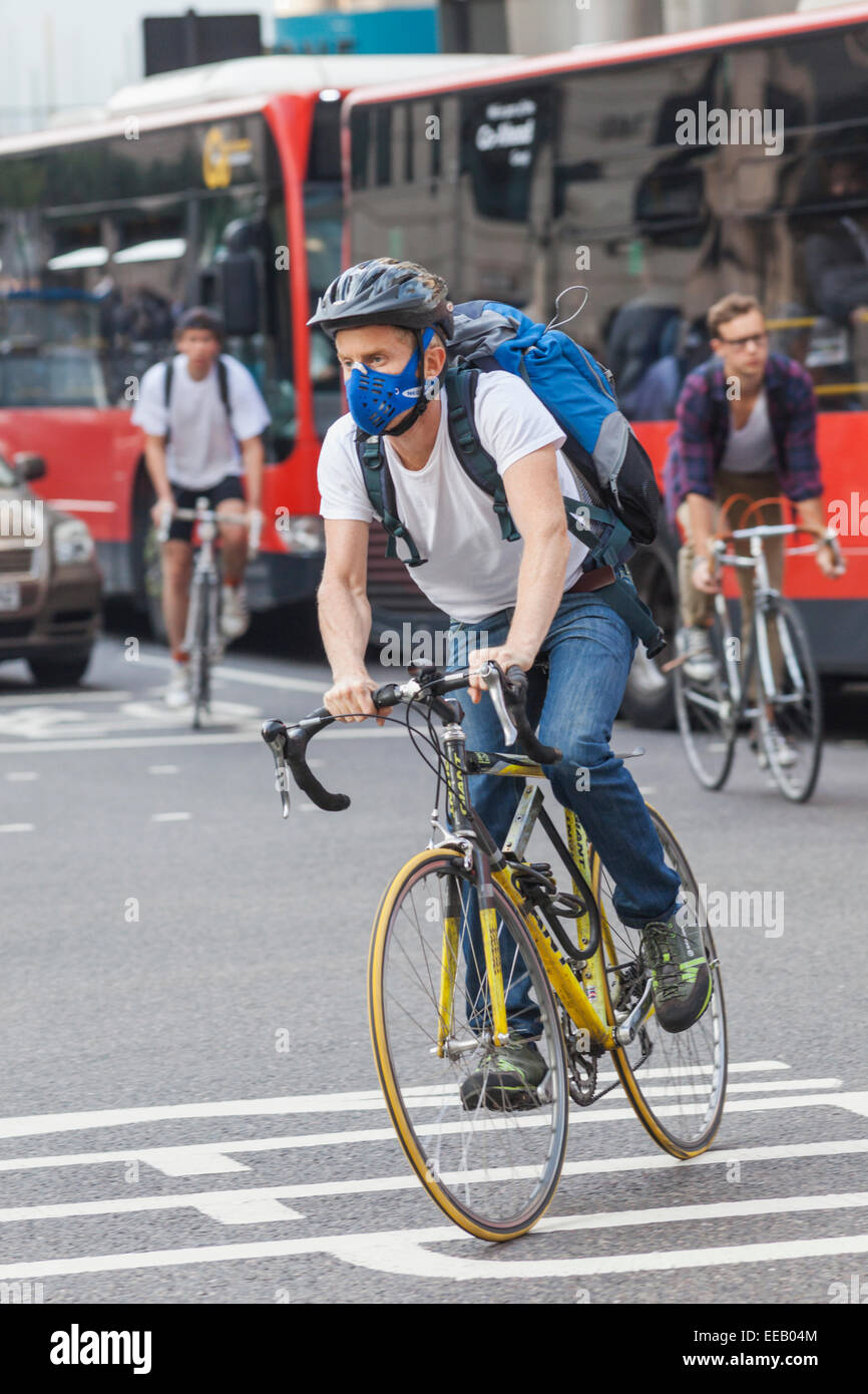 England, London, City of London, Cyclist in Traffic - Stock Image