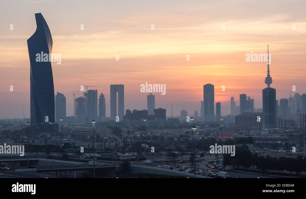 Kuwait City skyline at sunset - Stock Image