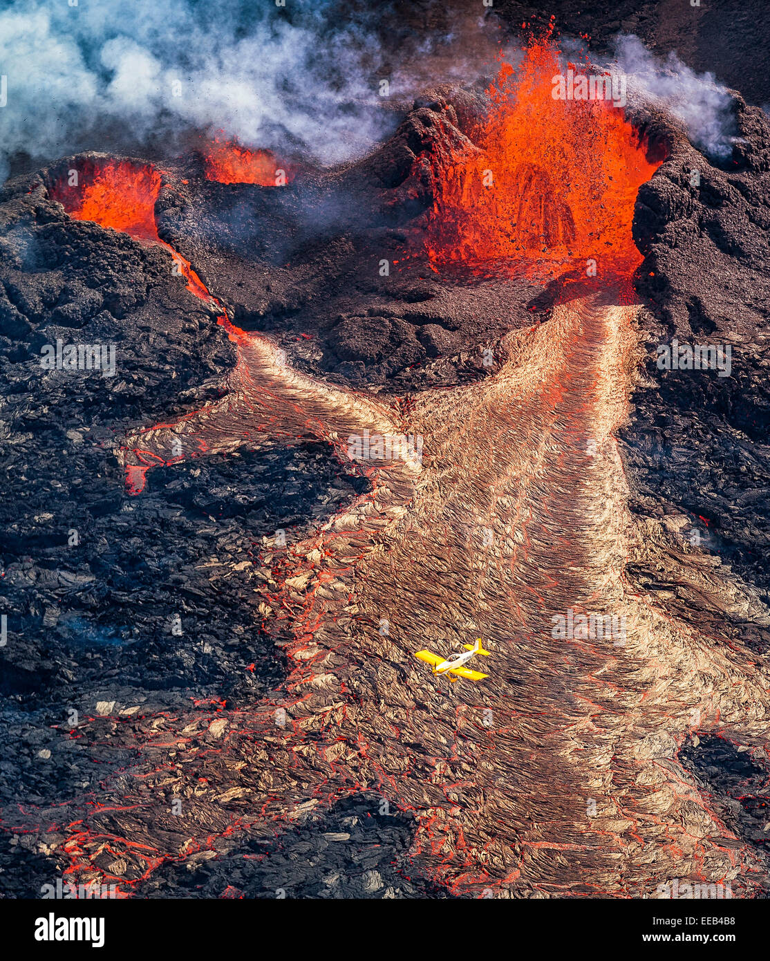 Small airplane flying over the volcano eruption at Holuhraun, Bardarbunga Volcano, Iceland. Picture Date: Sept, - Stock Image