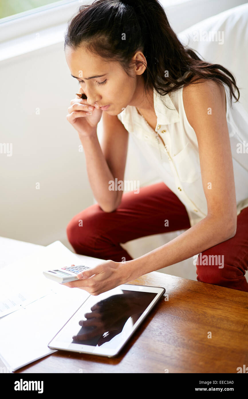 Girl working out finances - Stock Image
