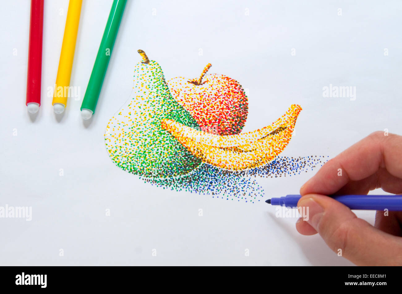 Man's hand making a pointillism drawing with color markers. Close view. - Stock Image