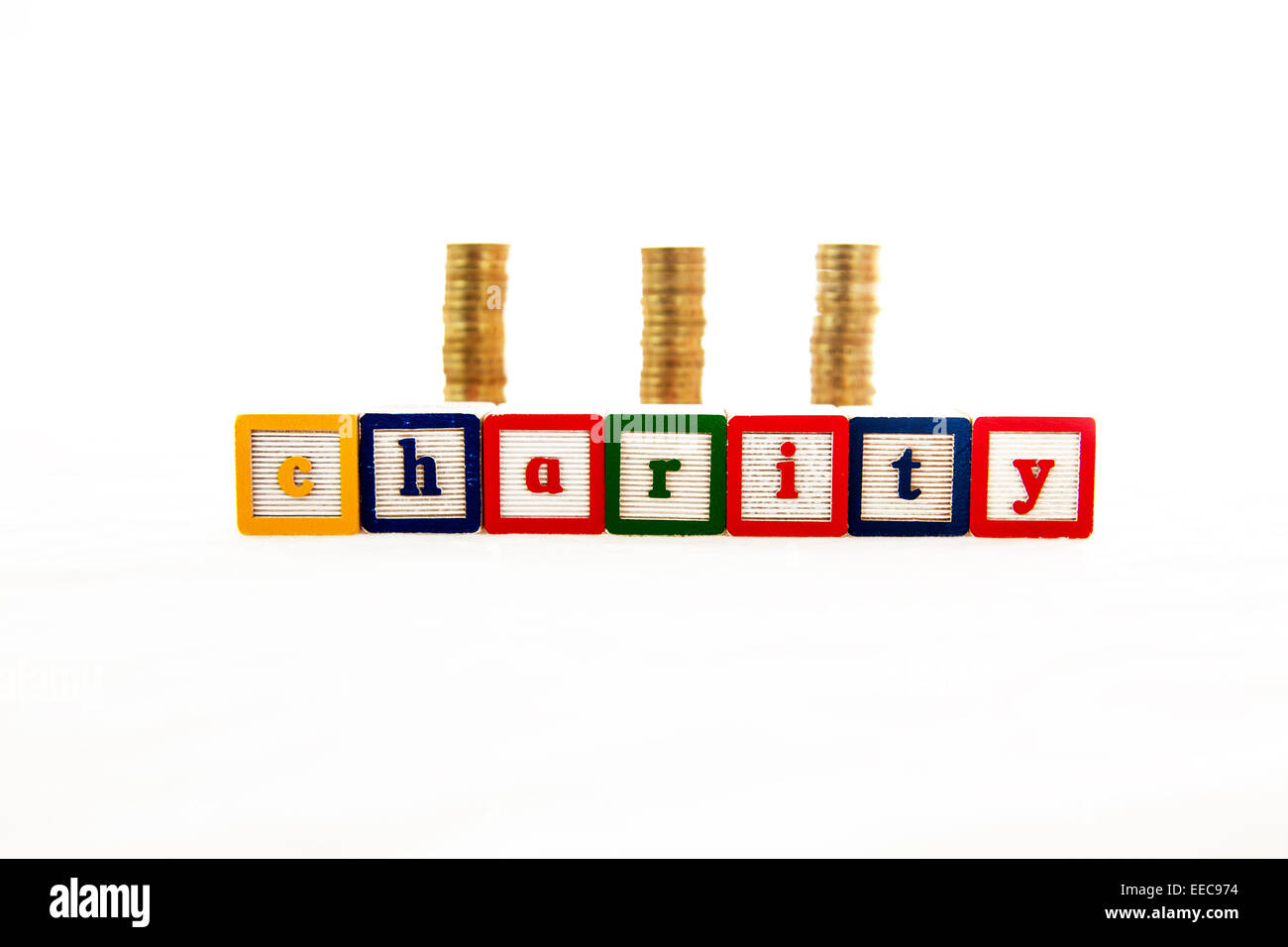 Charity fund funds money donation donations cash pounds coins word coin stacks cut out copy space white background - Stock Image