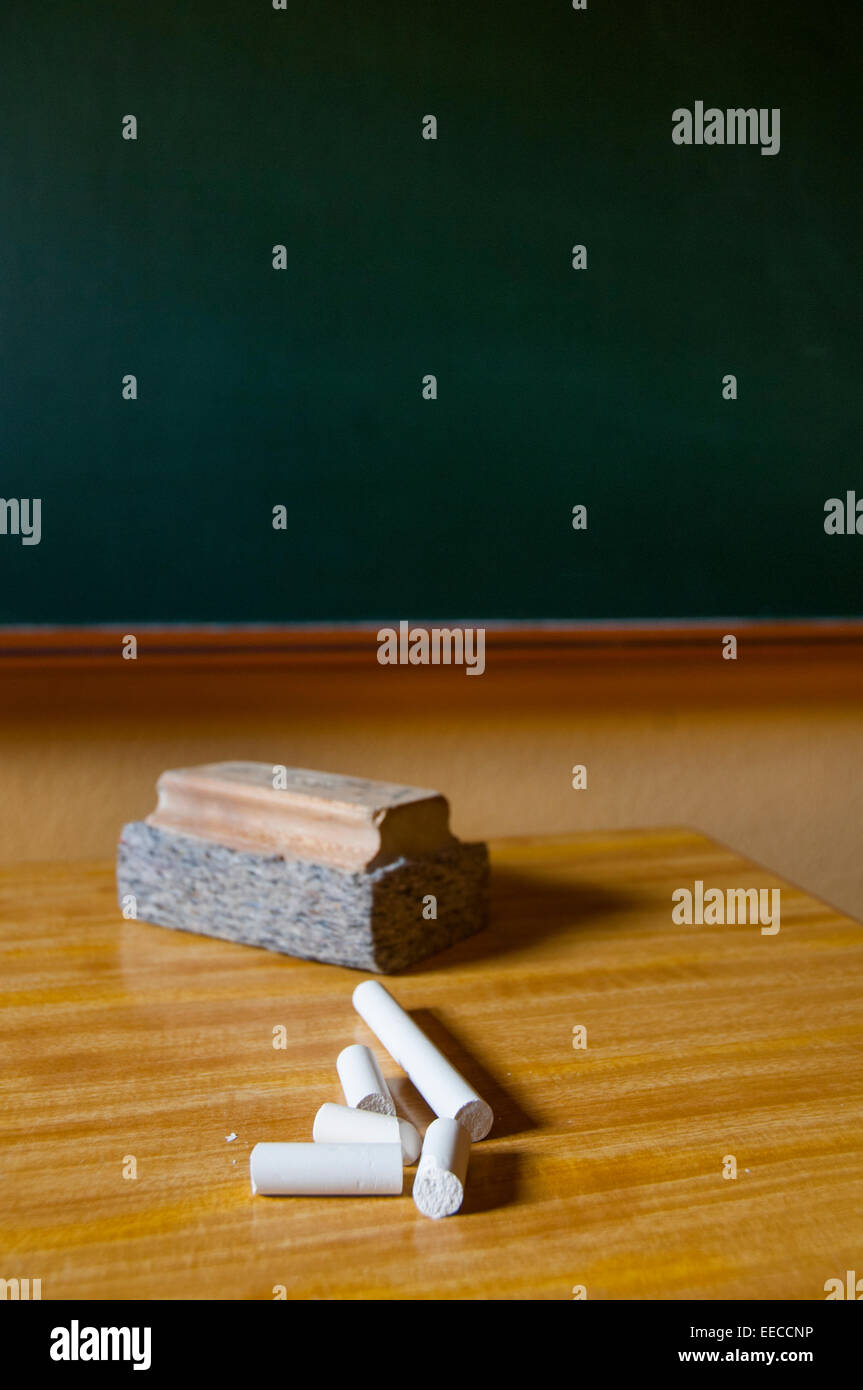 Chalks and board rubber on teacher's table. Close view. Stock Photo