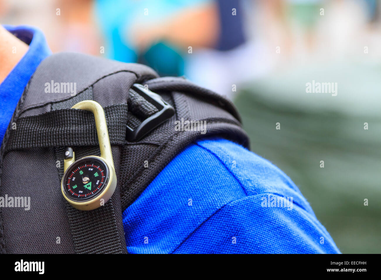 Compass attached on the bagpack of a hiker - Stock Image