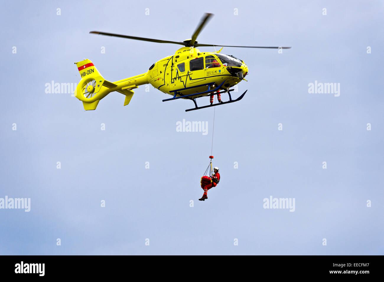 Rescue helicopter Eurocopter EC135 T2+ of the University Hospital Geneva in an emergency operation, Geneva, Switzerland - Stock Image