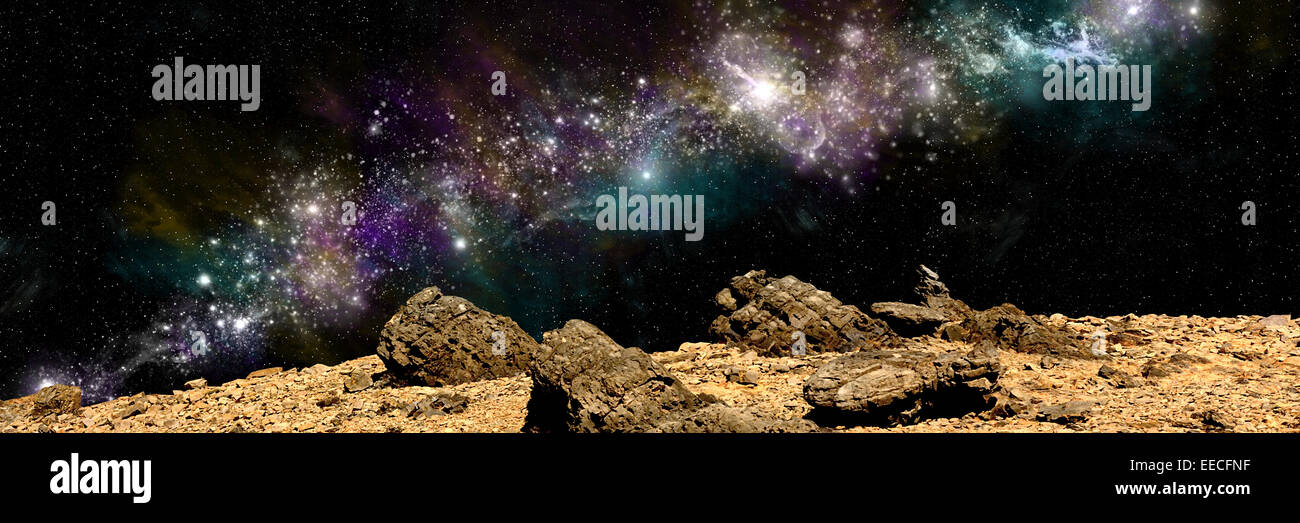 An artist's depiction of the view from a rocky and barren alien world. A large, colorful nebula rises over the - Stock Image