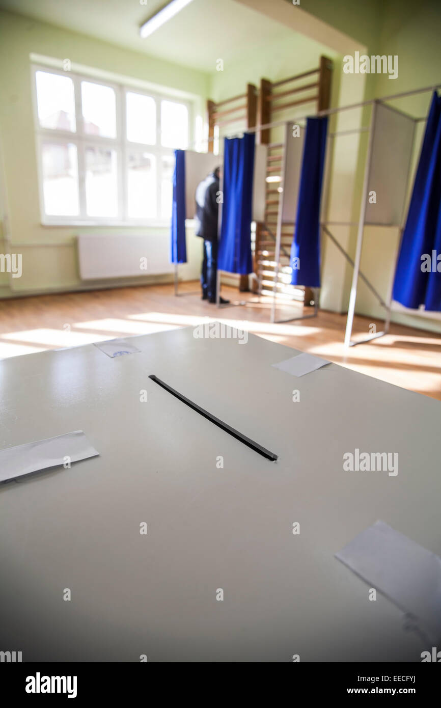 Color shot of a poll at a polling station. - Stock Image