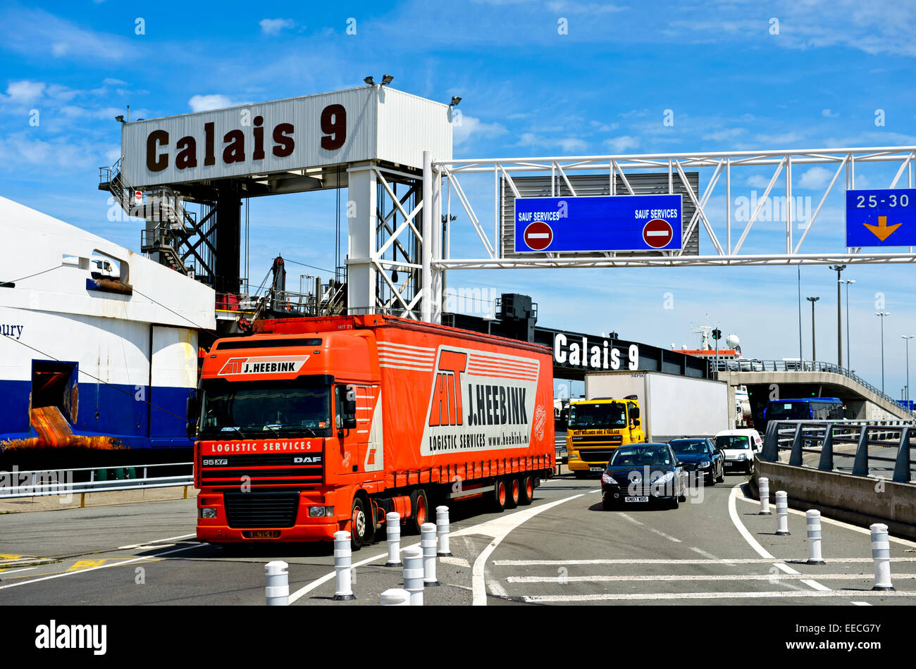 Trucks and cars disembarking from a cross-channel ferry at the cross-channel terminal 9 of the port of Calais, France - Stock Image
