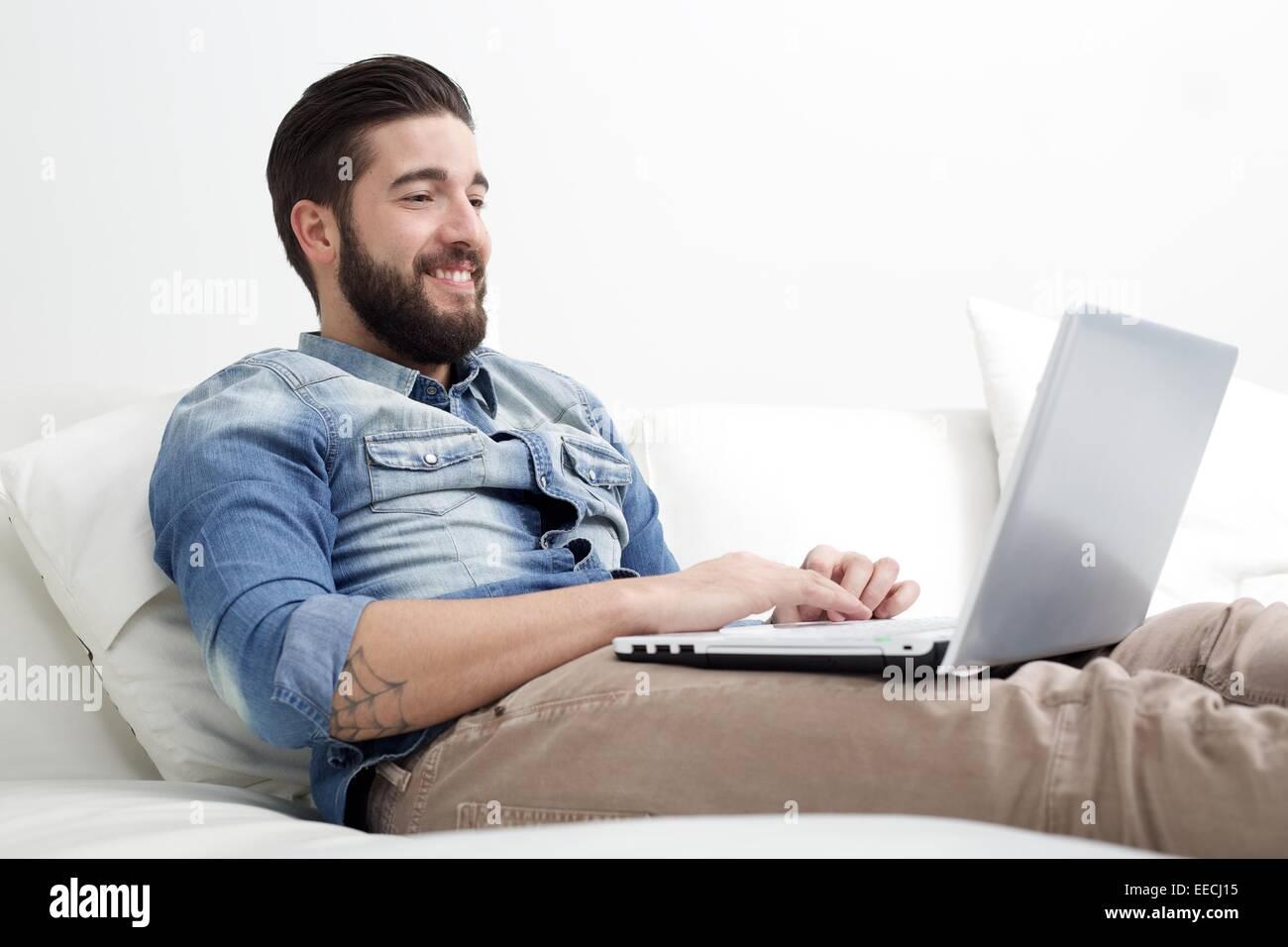 man watching laptop - Stock Image