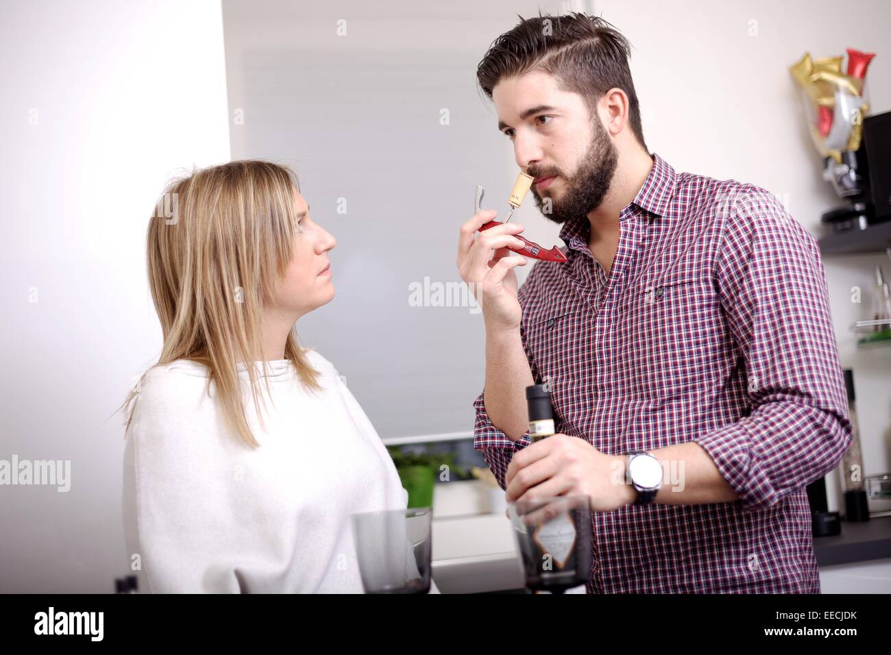 young couple drinking - Stock Image