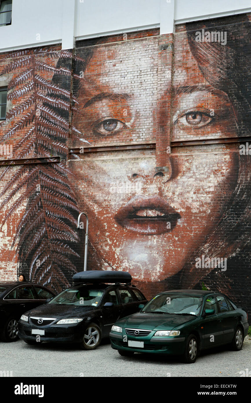 Mural on side of brick building in the inner city red zone of Christchurch, New Zealand - Stock Image