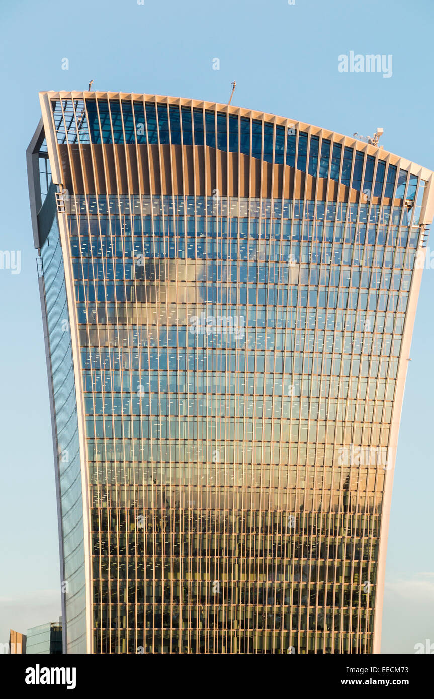 Reflection of evening clouds in the top of the Walkie Talkie Building, 20 Fenchurch Street, in the City of London, - Stock Image