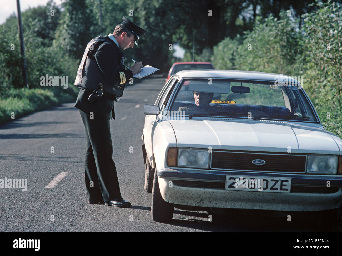 COUNTY TYRONE, UNITED KINGDOM-SEPTEMBER 1980. RUC, Royal Ulster Constabulary, police on Vehicle Stop during the Stock Photo