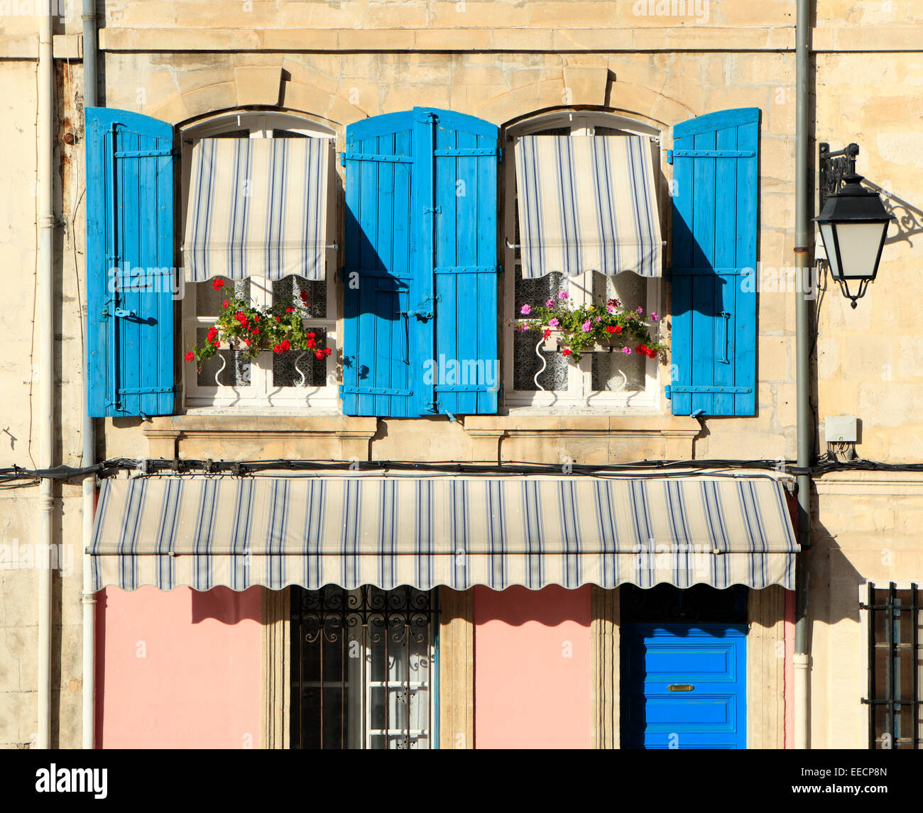 Typical French Provence Style Windows With Blue Shutters And