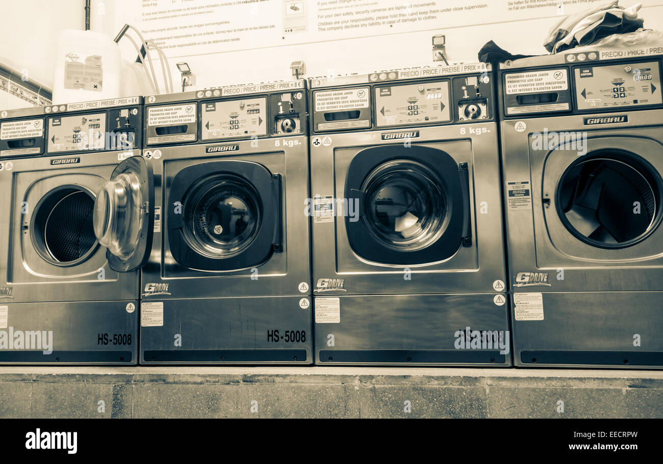Wahing machines in Laundrette - Stock Image