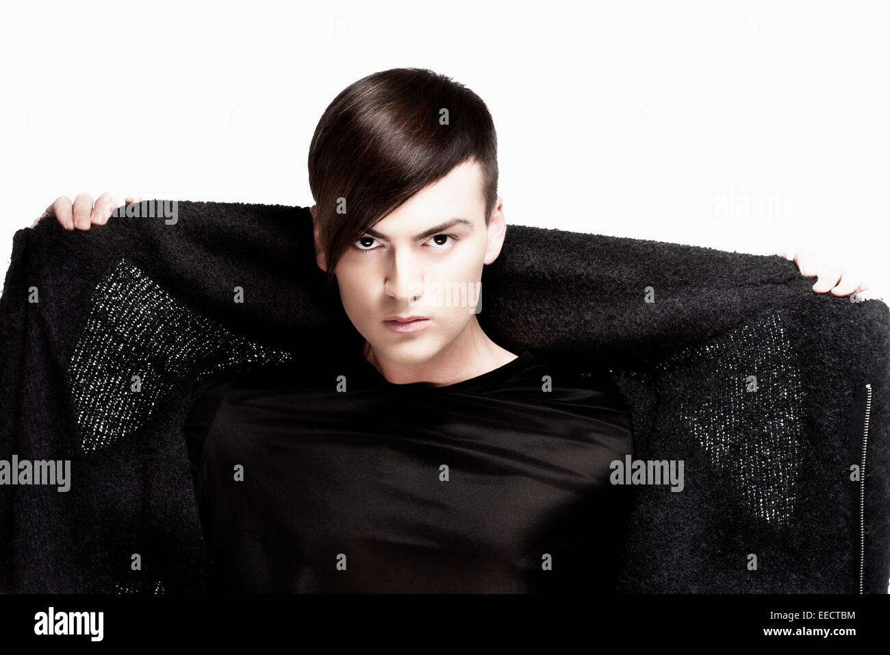 Portrait of a Young Man with Trendy Haircut - Isolated on White - Stock Image