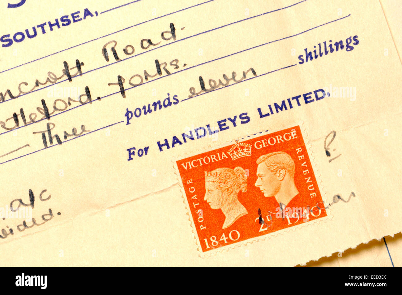 Postage stamps used to legally validate a receipt - George VI, 1941 Stock Photo