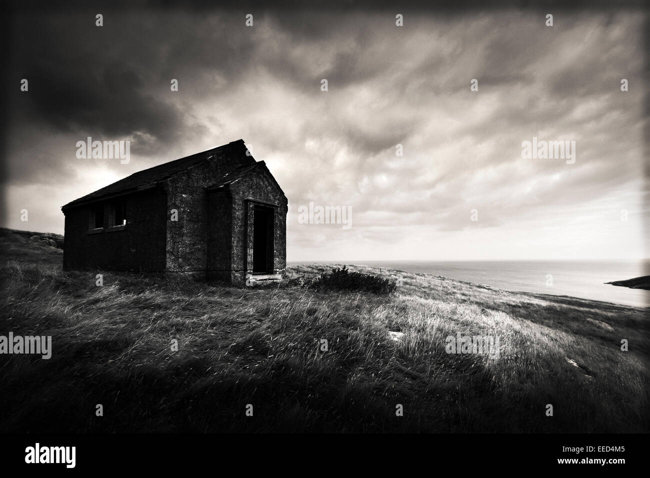 Stone Cottage on Isle Of Barra, Outer Hebrides, Scotland - Stock Image