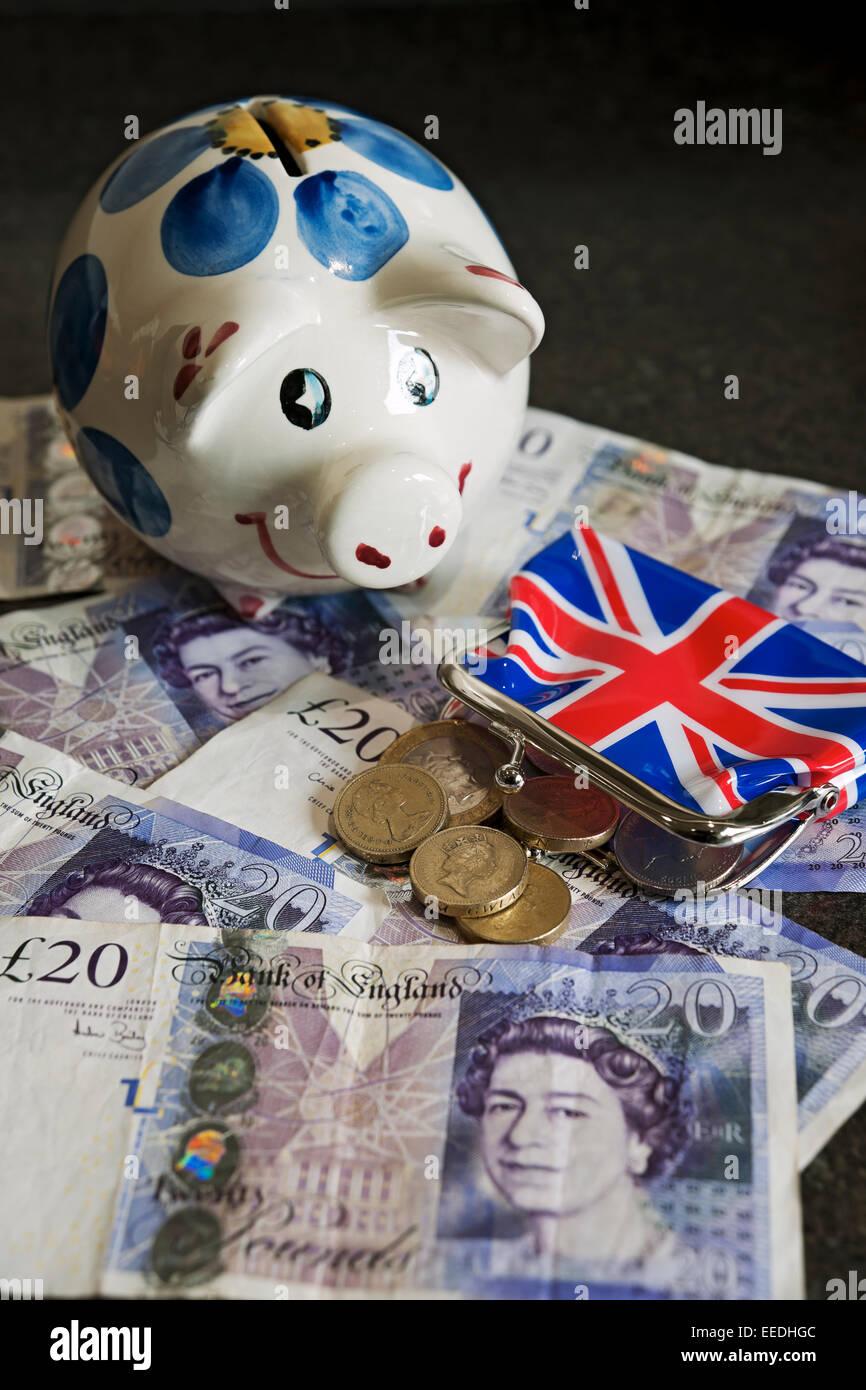 Piggy bank and English money England UK United Kingdom GB Great Britain - Stock Image