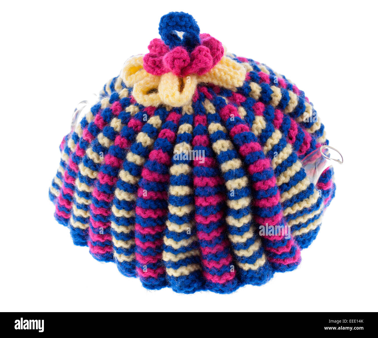 Knitted wool teapot cosy over a  glass teapot - Stock Image